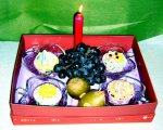 CSG11 Cupcakes in a box with a candle and grapes.